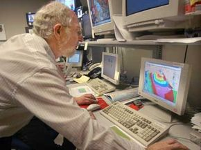 A meteorologist for the National Hurricane Center (NHC) runs a storm surge computer model on a portion of the Louisiana coast in October 2002.