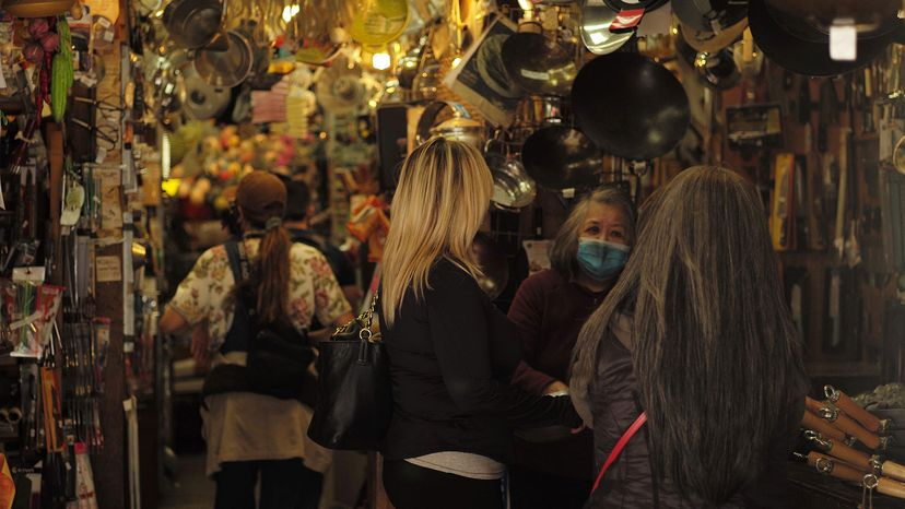 Tourists visit a shop in the San Francisco Chinatown
