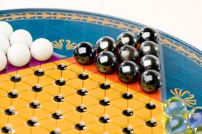Chinese checkers has little to do with traditional checkers and even less to do with China.
