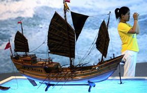 A tourist visits a model of a Medieval Chinese junk during the 600th anniversary celebration of Zhang He's famous voyages.