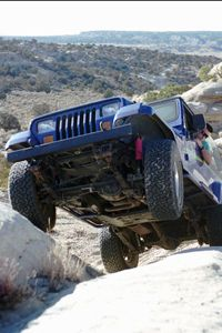 Garrett Sisson puts himself and his Jeep in a precarious position while off-roading with a group of other four-wheel drive enthusiasts in the Chokecherry Canyon area near Farmington, N.M.