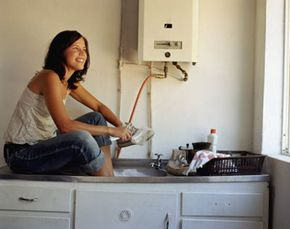 This young lady is clearly happy with her point-of-use tankless water heater.