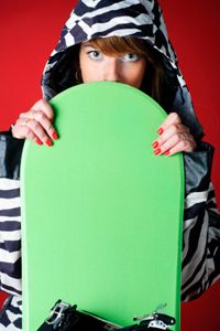 When the snowboard is standing on end, its tip should rest between your chin and nose.