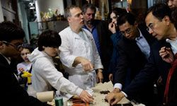 Jacques Torres of Jacques Torres Chocolate shows visitors some strong South American chocolates.