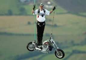 Stuntman Ian Ashpole gets ready to drop with his custom chopper from a hot air balloon at 3,000 feet.
