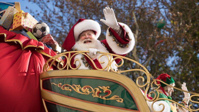 Santa waves to parade goers.