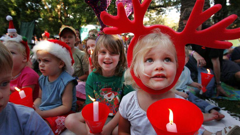 Australian children listen to Christmas carols.