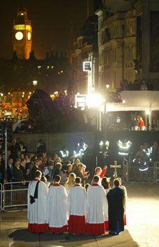 Children sing Christmas carols in Trafalgar Square, London.