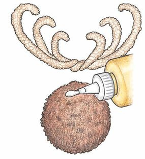Chenille stems are curled and glued to create the antlers of the reindeer.