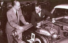A 1954 Plymouth Belvedere hardtop was the testbed for the Chrysler CR1 gas turbine engine. Project engineer George Huebner Jr. is on the right.