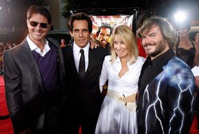 """The introductory scene of """"Tropic Thunder,"""" featuring Tom Cruise, left, Ben Stiller, second from left, and Jack Black, right was shot continuously. They are shown here at the premiere with Dreamworks CEO Stacey Snider. See more movie making pictures."""