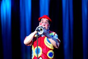 A member of the Clowning Caveagna Family plays the trumpet during a clowning bit on the opening night of the Ringling Bros. and Barnum & Bailey Circus in West Palm Beach, Florida.