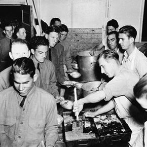 CCC boys rotated kitchen duty. Here, men wait in line for food at Camp Sanders in Mount Herndon, La.