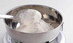 Sprinkle some flour on liquid grease for an easy cleanup.