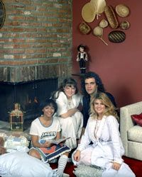 (L-R) Tootie, Natalie, Blair and a very handsome stranger settle by the fireplace for a cosy pajama party.