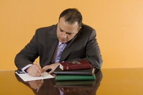 minister fills out paperwork