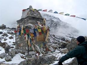 A Sherpa memorial cairn with prayer flags.