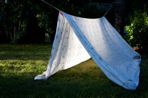 Sheet, line, pins, done: a clothesline tent defines ease.