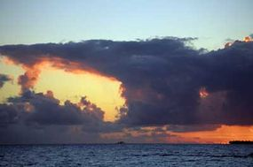 Cumulonimbus clouds, like these above French Polynesian waters, may mean rain is on the way.