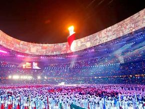 Downpours didn't snuff out the torch during the opening ceremony of Beijing's 2008 Olympic Games. Was it a matter of good luck or even better science? See more weather pictures.