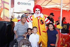 Ronald McDonald poses with fans during the Latin Grammy Street Parties 2013 in Phoenix, Ariz.