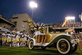The Ramblin Wreck leads the Georgia Tech Yellow Jackets onto the field in Atlanta. Georgia Tech is a public college with an excellent reputation and a full tuition of only $8,258 for in-state students in 2013-14.