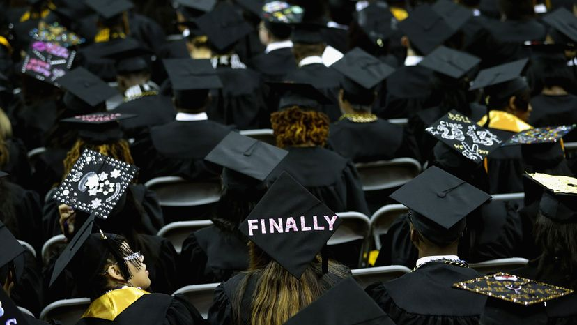 Graduates of Bowie State University put messages on their mortarboard hats