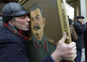 At a rally marking Stalin's 128th birthday anniversary on Dec. 21, 2007, a man holds a portrait of the Soviet dictator.