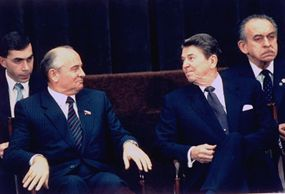 Soviet leader Mikhail Gorbachev (Left) and U.S. President Ronald Reagan exchange glances during a summit. 