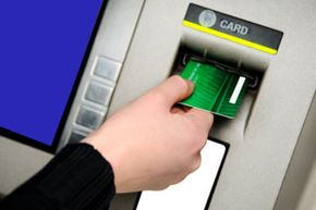 Be cautious at the ATM -- there are several scams thieves can use to steal your money. See more pictures of money scams.