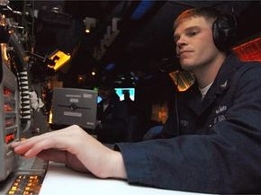 A fire controlman operates the radar system control during a ballistic missile defense drill aboard the USS Lake Erie. Air-conditioning technology could someday cool the microprocessors that run these types of weapons systems.
