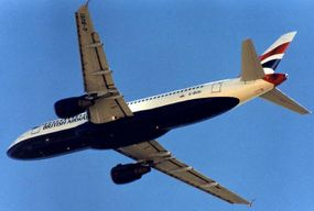 Airbus 320 in-flight: Note that the engines are attached underneath the wing with struts.