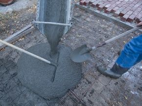 Pouring the concrete for a countertop is very similar to pouring the concrete for a driveway.