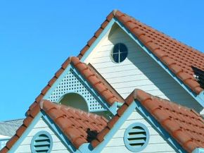 A study in terracotta, blue and white -- Spanish roof tiles on a wood clad house.