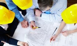 """The PM determines the cost and time goals as well as """"micro-goals"""" for the different phases of construction."""