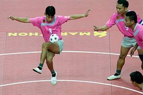 The Myanmar men's team competes with Thailand at the chinlone final of the 27th Southeast Asian Games in 2013.