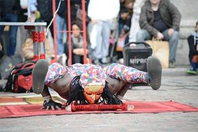 A contortionist, going by the name of Yogi Laser, puts on a special street performance for the public in London's Covent Garden.