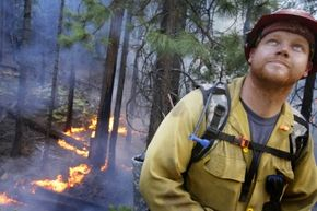 Captain Russell Mitchell with Yosemite Fire monitors a controlled backfire along Highway 120 at the southwestern edge of Yosemite National Park. The 2013 fire was set to keep a wildfire from progressing toward the Big Oak Flat Entrance Station.