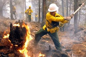 In 2002, Oregon firefighter Jose Martinez put out a hotspot from a controlled burn set to protect residents from an encroaching wildfire.