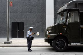 An officer writes a parking ticket for a UPS truck in New York.