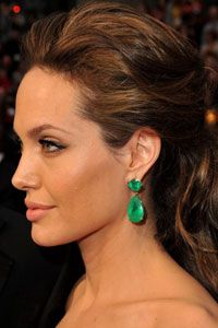 Angelina may wear the real thing, but it's likely the version popping up at the office Christmas party isn't authentic. See more celebrity pictures.
