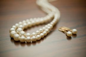 High-quality costume jewelry can look perfectly tasteful if worn in moderation.