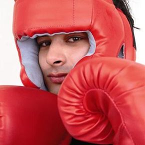 Ikram Haq, who received a double cornea transplant, poses in a photo showing his love for boxing to mark the centenary of the world's first successful cornea transplant in 2005.