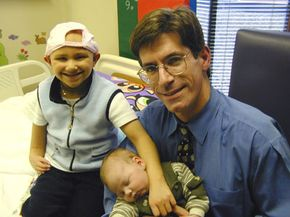 Cord blood specialist Dr. John Wagner holds baby Adam Nash on Oct. 17, 2000. Adam's cord blood was transplanted to his sister Molly (left), which cured her Fanconi anemia.