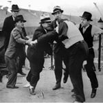 """Ford Service Department members assault union organizer Richard Frankensteen during the """"Battle of the Overpass"""" in 1937."""