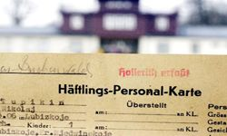 An IBM Hollerith punch card used to catalog a Russian slave laborer captured by the Nazis during WWII is photographed outside of the Buchenwald concentration camp.