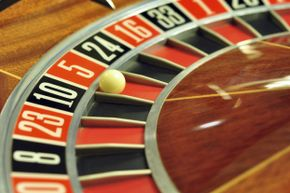 If red just came up seven times in a row on the roulette wheel, would you be more likely to bet on red or black before that eighth turn?
