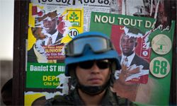 That's a Brazilian U.N. soldier, not a Haitian one, standing guarding in Port-au-Prince during the country's 2011 elections.
