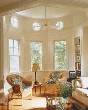 Architecture inspired by 19th-century lighthouse design helps, of course, but the                                            savvy mix of furnishings would work anywhere. Uncurtained windows, graceful                                            wicker porch chairs, a plain white modern sofa, and an early American-inspired                                            coffee table make an unlikely but charming mix.
