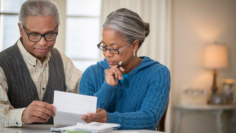 Elderly couple looking at 401K